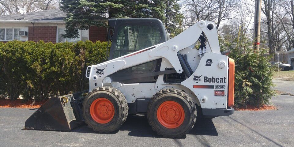 A 2014 Bobcat Skid Steer Loader for Sale in Boston
